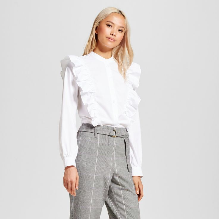 Gradated ruffles, button-down charm: the Ruffle Poplin Blouse - Who What Wear™ has it all. True to classic Victorian-style ruffles, the front of this top has gradated folds of fabric adding volume and interest; the simple white styling means you can match it with anything in your closet.