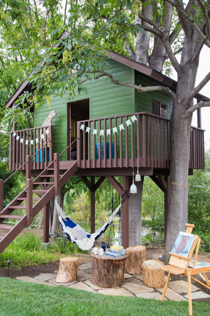 """I can't take credit for how cute the original structure is. It was already like that when I arrived. BUT I can take credit for the fun <a href=""""http://www.target.com/p/marimekko-for-target-sling-hammock-3-pc-125-kaivo-print-blue/-/A-50358593#prodSlot=medium_1_1&term=marimekko+hammock"""" target=""""_blank"""">hammock</a>, stump seating area, and awesome leopard sculpture that stands guard out front. I imagine him like the gatekeeper... what's the secret password??"""