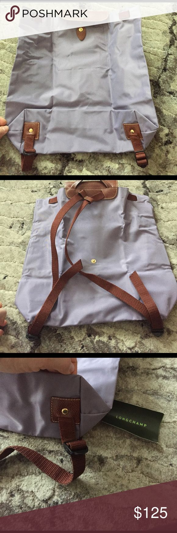 """Longchamp Backpack Brand New Authentic Longchamp Backpack, pull straps to close, foldable, very practical. Color is light Violet. Size is 5.5"""" x 7"""" when folded. Full open size is 14.5"""" x 14.5"""" x 4"""" depth. Longchamp Bags Backpacks"""