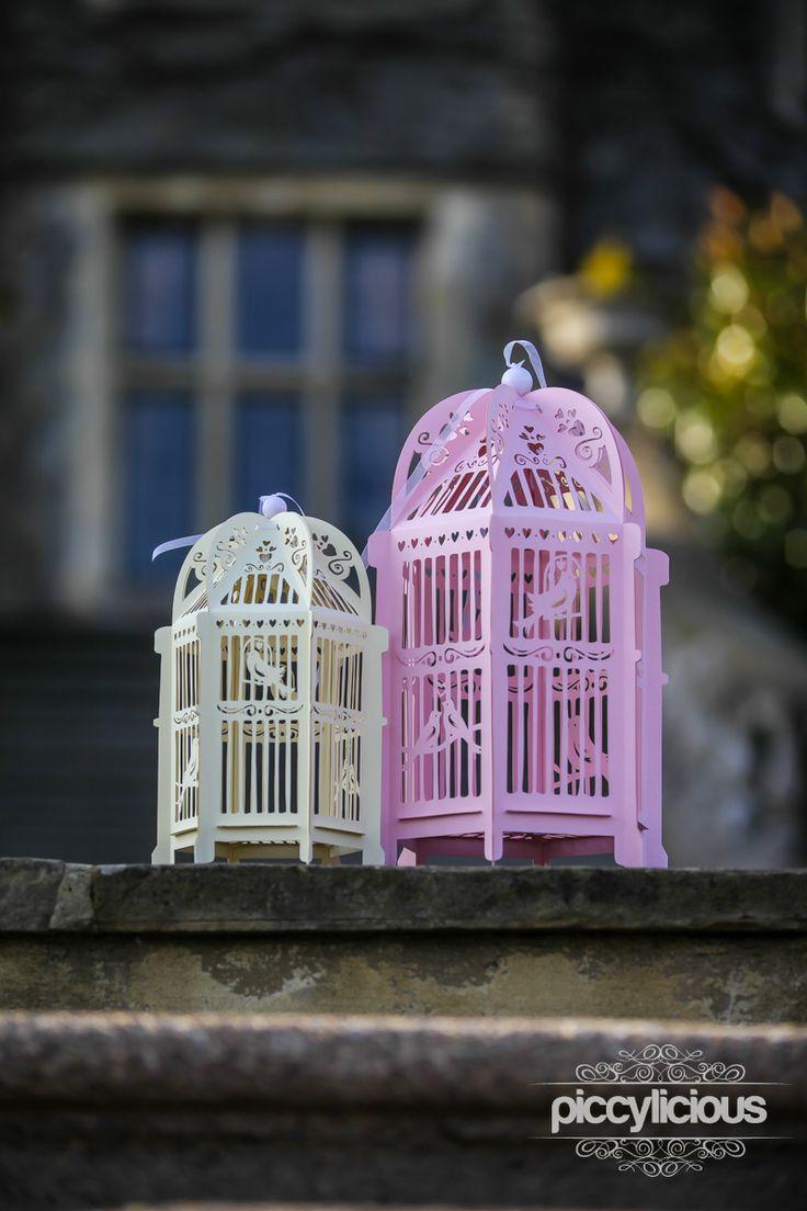 Ivory and pink birdcage lanterns.