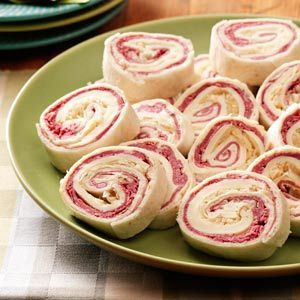 Reuben Rolls:  mix cream cheese, brown mustard and a dash of horseradish; spread on tortillas or wraps and top with corned beef, Swiss cheese and sauerkraut. roll, chill and slice!