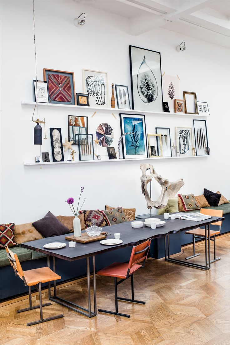 THE LOFT Amsterdam. Gallery wall on ledges, mixed chairs and kelim cushions. Nice.