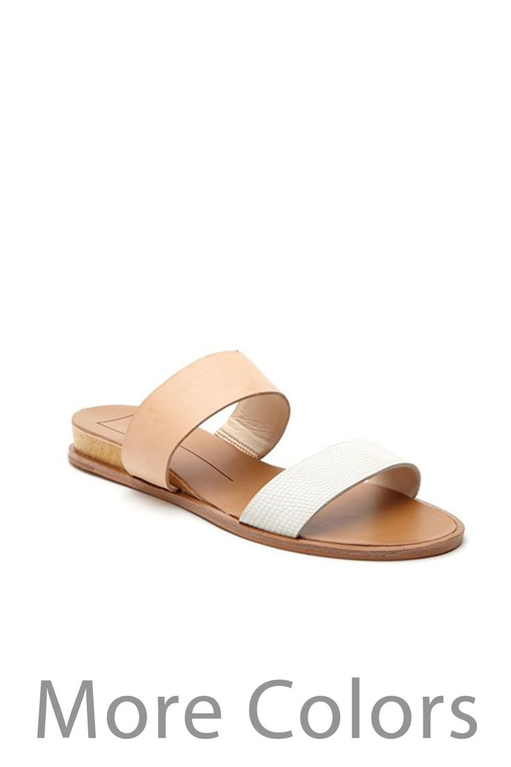 PRODUCT DESCRIPTION The PAYCE is a two strap slide with a sliver wedge that is perfectly modern. PRODUCT DETAILS: - Dolce Vita - 100% Man made Leather and 80% Man made leather, 20%