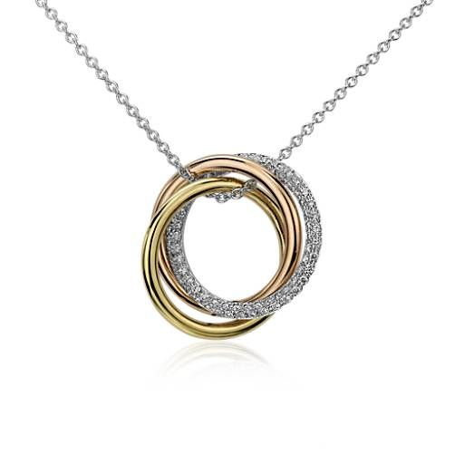 Rich in golden color, this circle diamond pendant features round diamonds pavé-set in the 14k white gold ring accented by 14k rose and yellow gold rings on a white gold necklace.