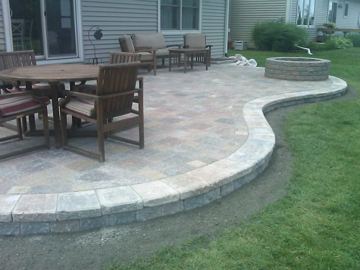 Here 39 s a raised curved paver patio with a fire pit for Fireplace on raised deck