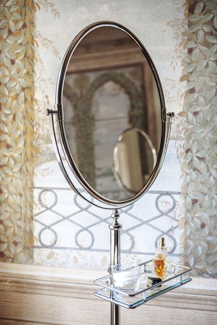 Joel freestanding mirror with glass shelf chrome.