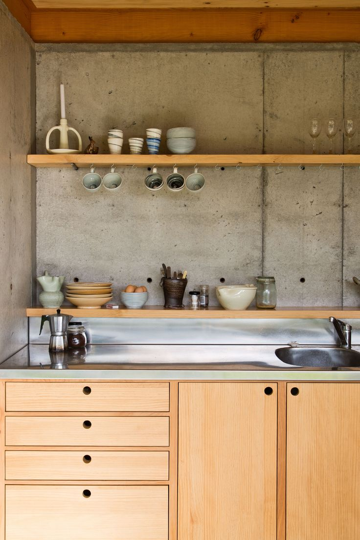 concrete slab walls and wooden bench cupboard kitchen patch work architecture - Kitchen Cabinets Nz