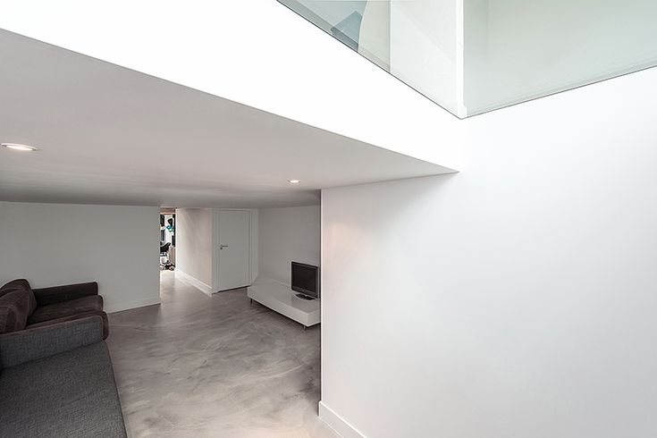 to open up this area and make it as light and airy as possible, everything between the kitchen and living room is made of glass.