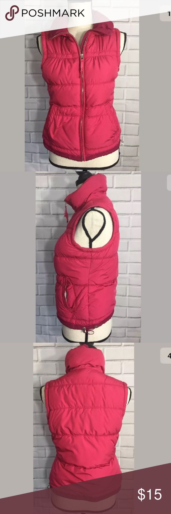 """American Eagle Pink Vest Jacket American Eagle Juniors/Womens Pink Puff Vest Size Small Shell: 100% Polyester Lining: 52% Polyester 48% Cotton  Fiber Fill: 100% Polyester  Approximate Arm pit to Arm pit: 18"""" Length: 21 1/2"""" American Eagle Outfitters Jackets & Coats Vests"""