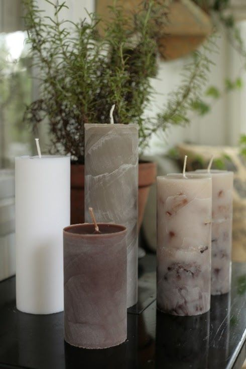 """new candles using Pringles chip tubes as """"molds"""" (the wax from old candles was melted down) 