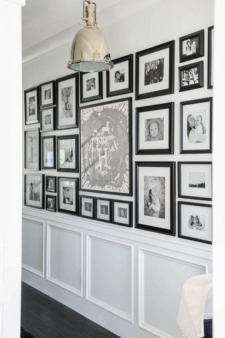 Black and white gallery wall down a long hallway.  Pawleys Island Posh: