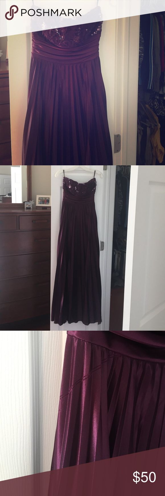 Purple (eggplant) Prom Dress Long strapless prom dress. Worn once. Has a slight snag on the right side but hardly noticeable. I thought it was part of the design. Dresses Prom