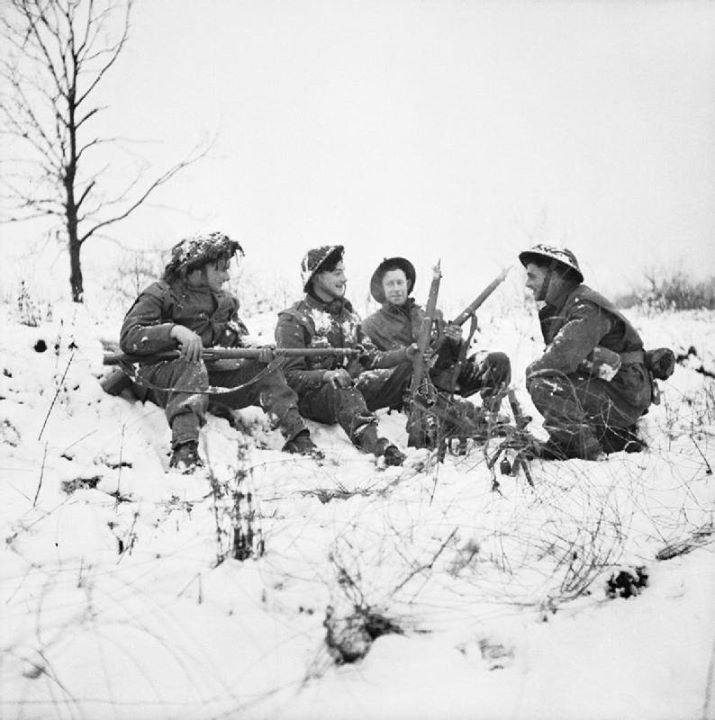 Infantry of 53rd (Welsh) Division in the snow near Hotton Belgium 4 January 1945.