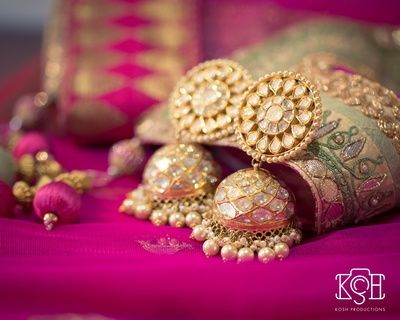 Indian Wedding Jewelry - Gold and Polki Earrings | WedMeGood #wedmegood #indianbride #Indianjewelry #jhumkis #polki #earrings
