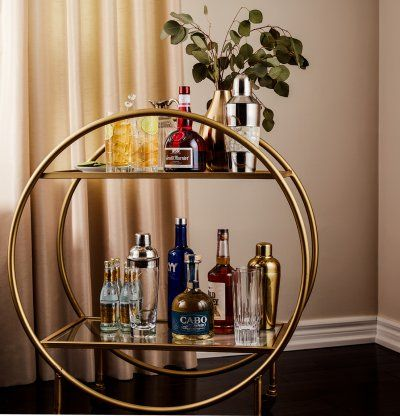Grand Marnier on a classic Art Deco round brass cocktail cart.