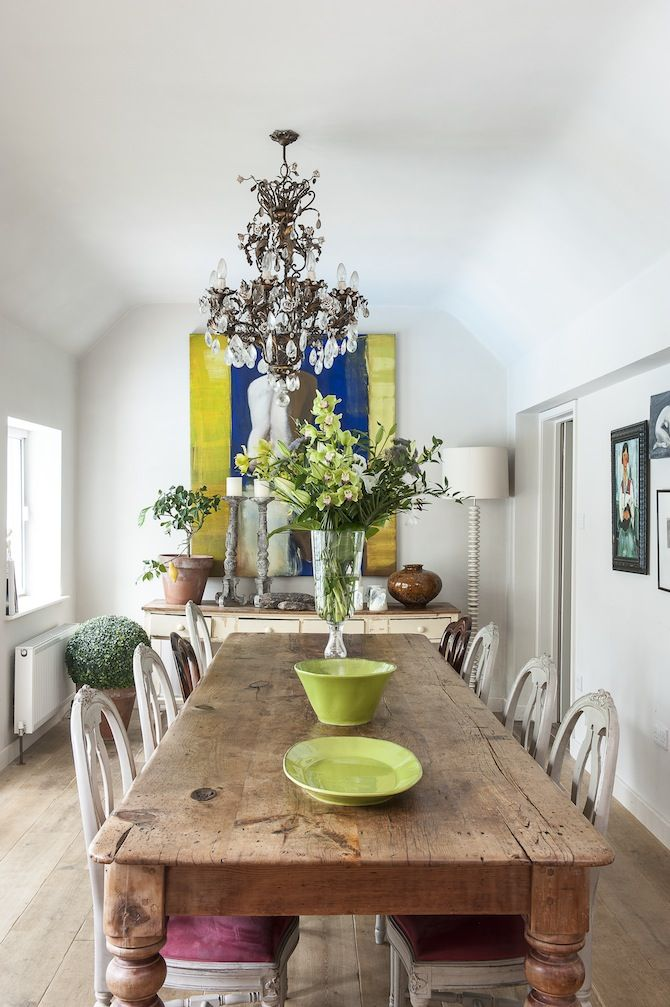 The beautiful rustic wooden dining table from inside art dealer Stella's stunning Wealden home.