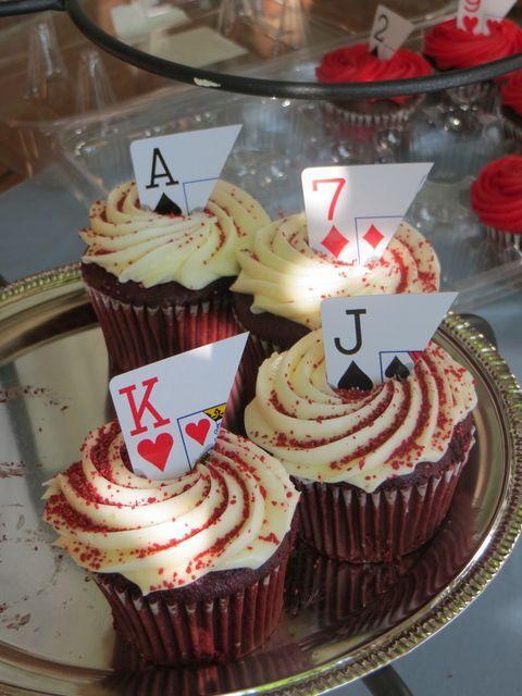 DIY playing card cupcakes at an Alice in Wonderland Party! See more girl birthday ideas at CatchMyParty.com