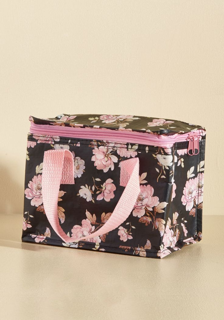 <p>Stash away your sandwiches and snacks easily and elegantly by employing this black lunch bag to host your fare! Thoroughly insulated and printed with pink French roses, this mealtime accessory offers a perfectly balanced blend of beauty and utility.</p>