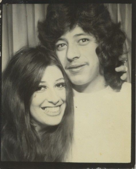 Vintage photo booth portrait. EXCITED,AFFECTIONATE YOUNG COUPLE.