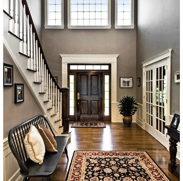 Foyer. I assume those doors are for a study, but I would prefer if it were a dining room. Also instead of the bench, I'd like book shelves and obviously more fun touches to make it my own.