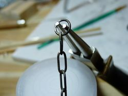 making oval chain links Squared off oval chain links out of sterling silver. Great tutorial