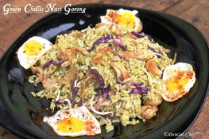 """Nasi goreng, literally meaning """"fried rice"""" in Indonesian, can refer simply to fried pre-cooked rice, a meal including stir fried rice in small amount of cooking oil or margarine, typically spiced with kecap manis (sweet soy sauce), shallot, garlic, tamarind and chilli and accompanied with other ingredients, particularly egg, chicken and prawns."""