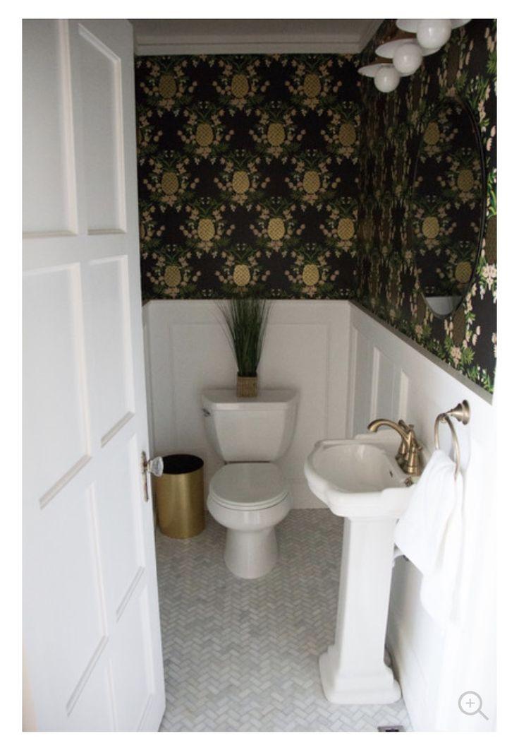 Half bathroom update: Rifle Paper Co Pineapple wallpaper from Hygge & West, Delta fixtures in champagne bronze, Home Depot herringbone tile.