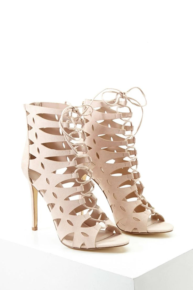 A pair of faux suede heels featuring a caged cutout design, lace-up front, and a stiletto heel.