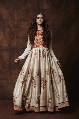 Indian Suits - Anarkali | Off White Anarkali with Red and Orange All Over Embroidery on Top, and Minimal Orange and Red Work on Kalis | WedMeGood #wedmegood #indiansuits #anarkali