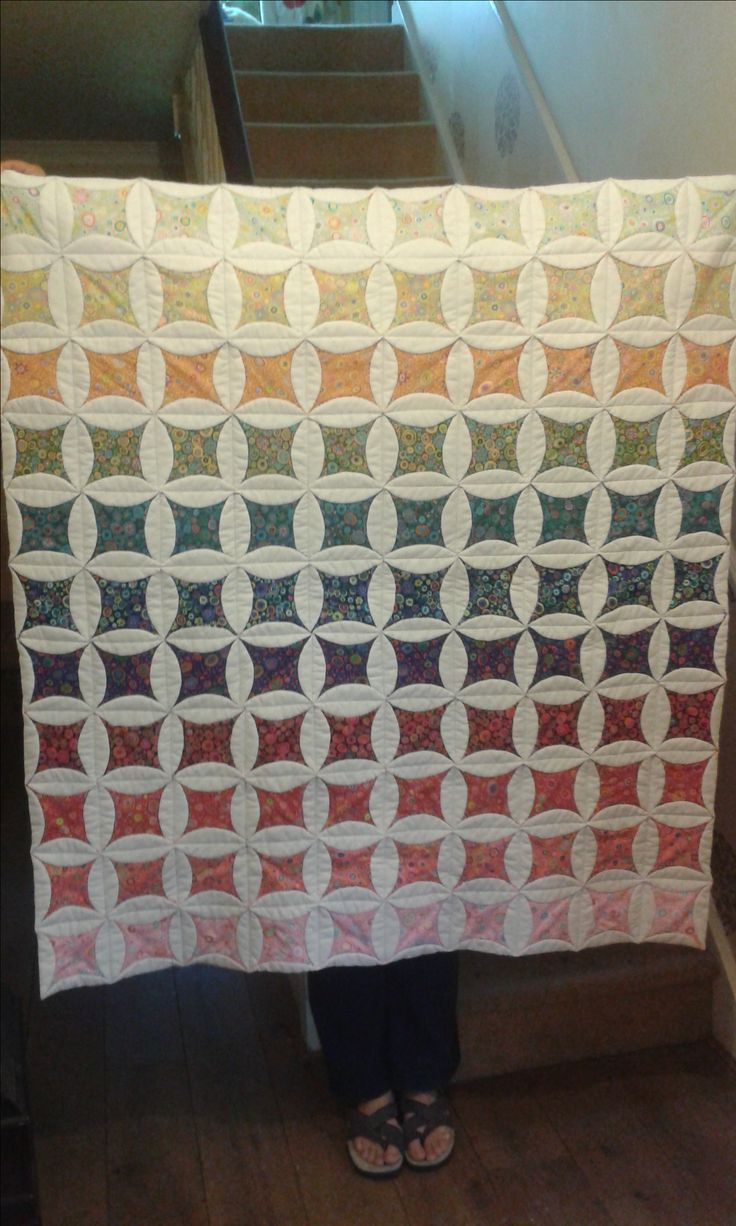 I wanted to make a rainbow quilt with Kaffe Fassett Roman Glass fabric.  I love the charming circles pattern - so this is the result.