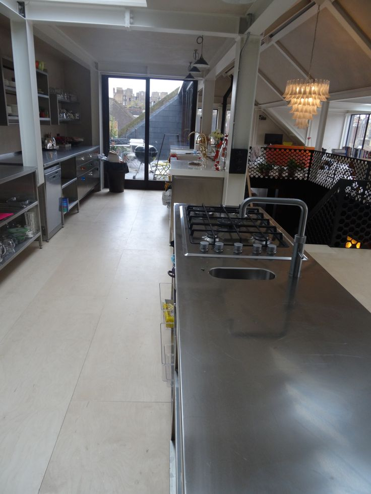 Galley kitchen with GEC Anderson modular stainless steel worktops, cabinets and shelving