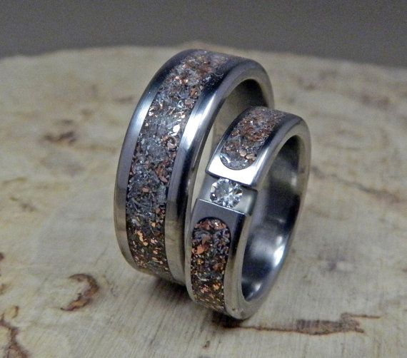 "Titanium Wedding Band Set- Tension Set Junk and Moissanite Set. $355.00, via Etsy.   This is ""us!"""