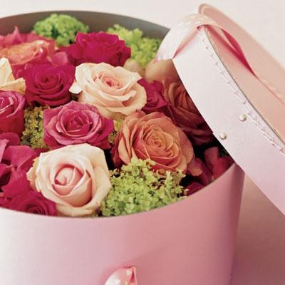 London floral designer Paula Pryke roses in a pink hatbox