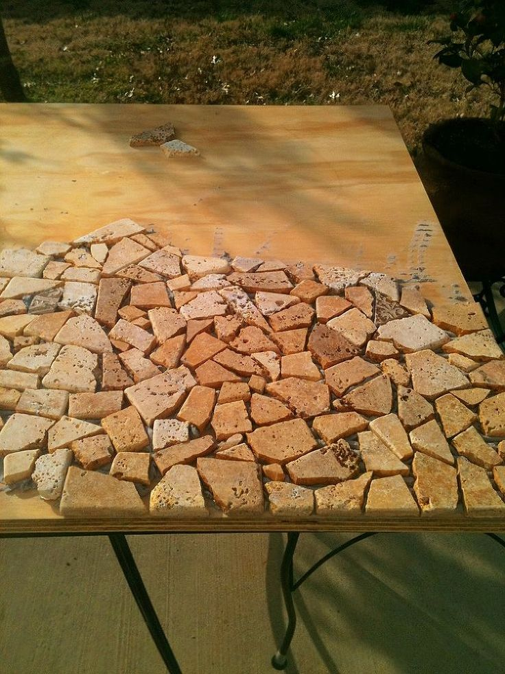 update your old glass patio table with a funky diy rock mosaic