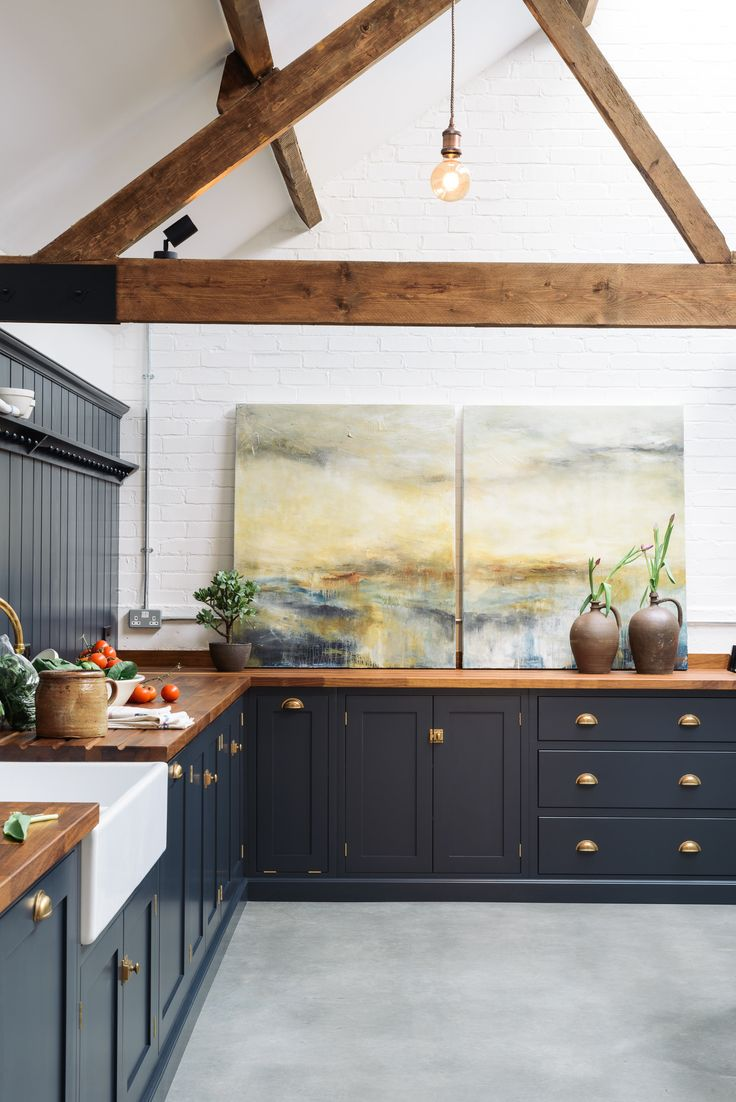 This Shaker kitchen is huge and yet it still seems to feel comfortable and homely and has the clever ability to feel both industrial and a little bit country chic.Our Pantry Blue paint colour look perfectly at home in this renovated cattle shed.