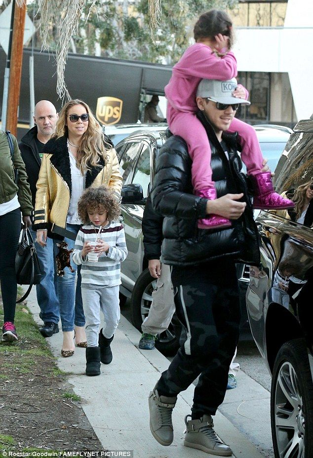 Happy family: Mariah Carey and boyfriend Bryan Tanaka were spotted taking her children to gym class in LA on Thursday