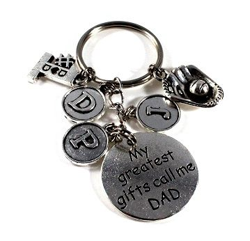 "This special Key Chain will come standard with the round 'My Greatest Gifts Call Me Dad' Charm...you may select FOUR ADDITIONAL charms such as initial charms for Dads children, sport charms (AWESOME for Coach Daddy), Jersey #'s and/or Religious Charms.  This handmade key chain is approximately 3.5""  from end to end - perfect for Dads Keys!"