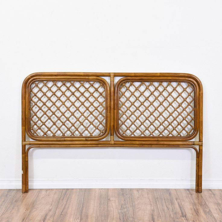 This rattan headboard is featured in a solid bamboo wood with a glossy finish. This wicker headboard is in great condition with a tightly woven pattern, two legs, and space for two. Perfect for creating a boho chic look! #coastal #beds #headboard #sandiegovintage #vintagefurniture