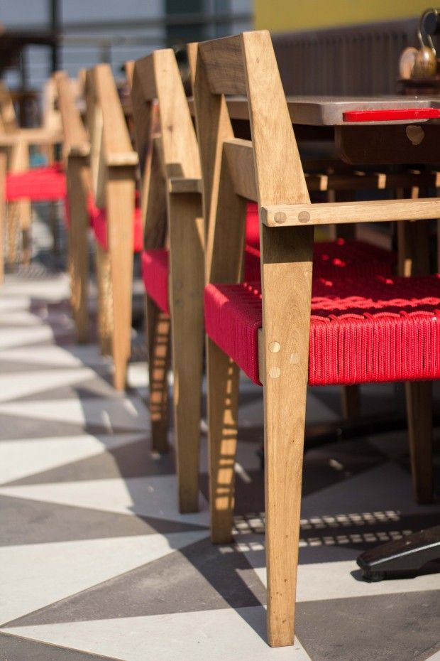 A lineup of our rope weave seated Paindane chairs at home at Nando's in Maponya Mall.