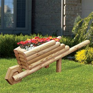"""Landscape Timber Wheelbarrow Planter Plan.  What a cleaver way to plant and display your Spring flowers. Make from landscape timbers and plywood. 28""""H x 36""""W x 28""""D   Plan #2187  $12.95  ( crafting, crafts, woodcraft, pattern, woodworking, yard art, landscape timber, planter ) Pattern by Sherwood Creations"""