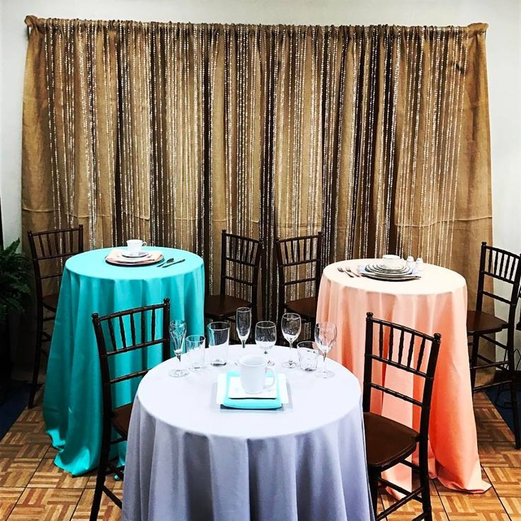 Burlap backdrop with colorful table setting options. Turquoise, peach or purple table settings are perfect to add some color to your wedding day!