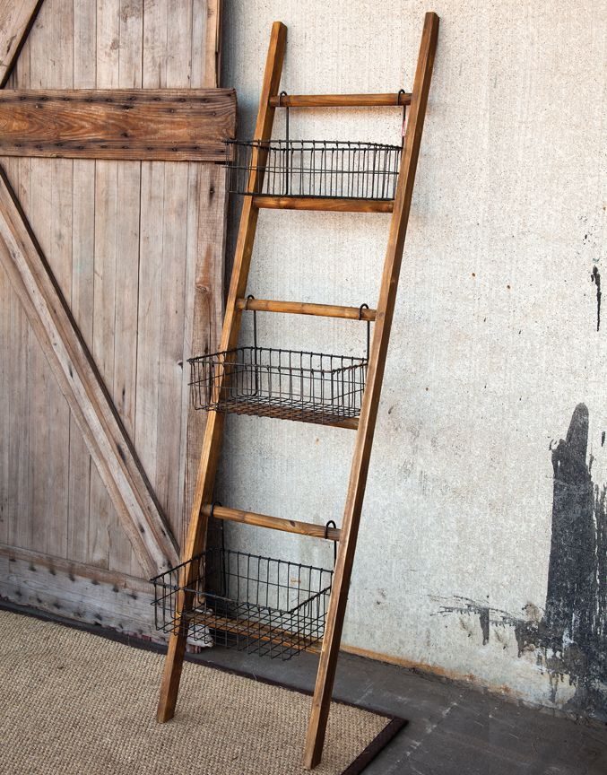 Not a ladder used for reaching the out of reach. Conveniently it serves to keep daily needs right in front of your eyes. Seventy two inch tall wood ladder leans against the wall and offers three graci...
