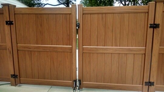 Driveway Gate With A Spring Loaded Gate Wheel Made For