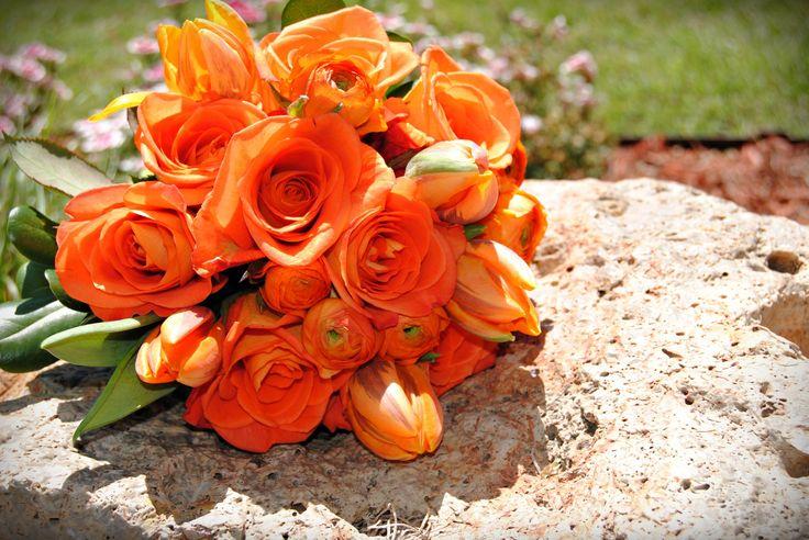 orange rose, ranunculus and tulip bride bouquet - £70.00
