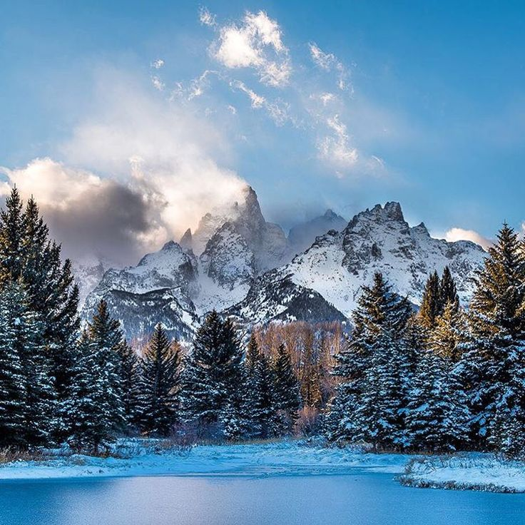 A gorgeous snowy scene of Grand Teton National Park in Wyoming. Josh Packer took this photo at Schwabacher's Landing. After hiding behind thick clouds for several hours, the Tetons decided to make an appearance right at sunset, creating this magnificent view! Photo courtesy of Josh Packer.