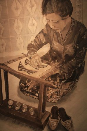 painting of a Nyonya making the shoes by May Oon from an old photograph #Singapore #artisan #vintage #Peranakan