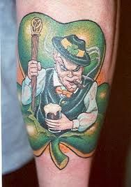 Suitable small tattoos for men include heritage style art. If you are of Irish background, a tasteful shamrock grouping would be appropriate, but a drunken leprechaun is not. The same could be said for all ethnic backgrounds. A fat, smiling Italian pizza chef with a cheese pizza does not represent all Italian descendants. There are hundreds of other cyphers which better symbolize the Italian culture. Look at a country's flag, ancient buildings and foliage for ideas.