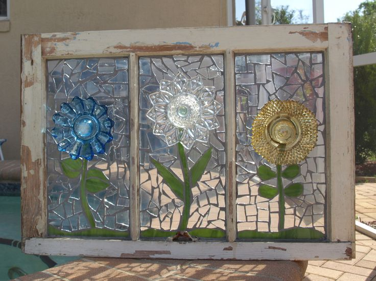 clear glass mosaic glued to original glass then grouted in a coordinating color and sealed then glue on dishes for flowers... gorgeous.