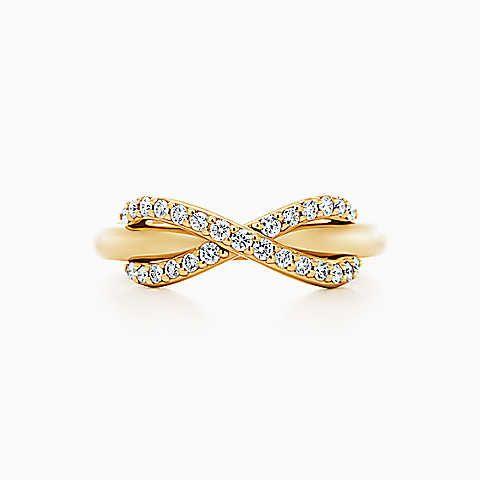 Anello Tiffany Infinity in oro 18k con diamanti.