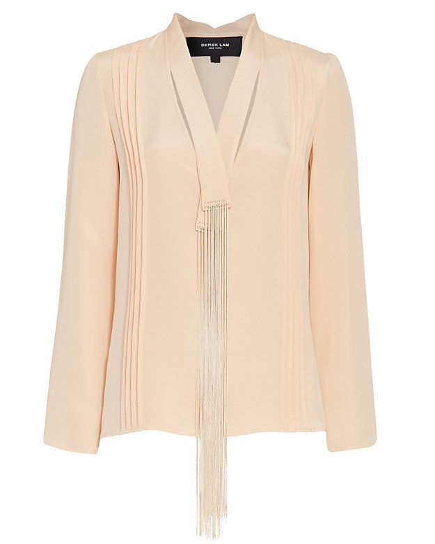 Derek Lam Fringe Tie Blouse: Nude: A luxe silk blouse constructed with fringed tie-inspired detailing at the neckline. Subtle pleats. Slits at sides of hemline. In nude.  Fabric: 100% silk  Model Measurements: Height 5'10 1/2; Waist 24 ; Bust 31 wearing size 38 Length from shoulder to ...